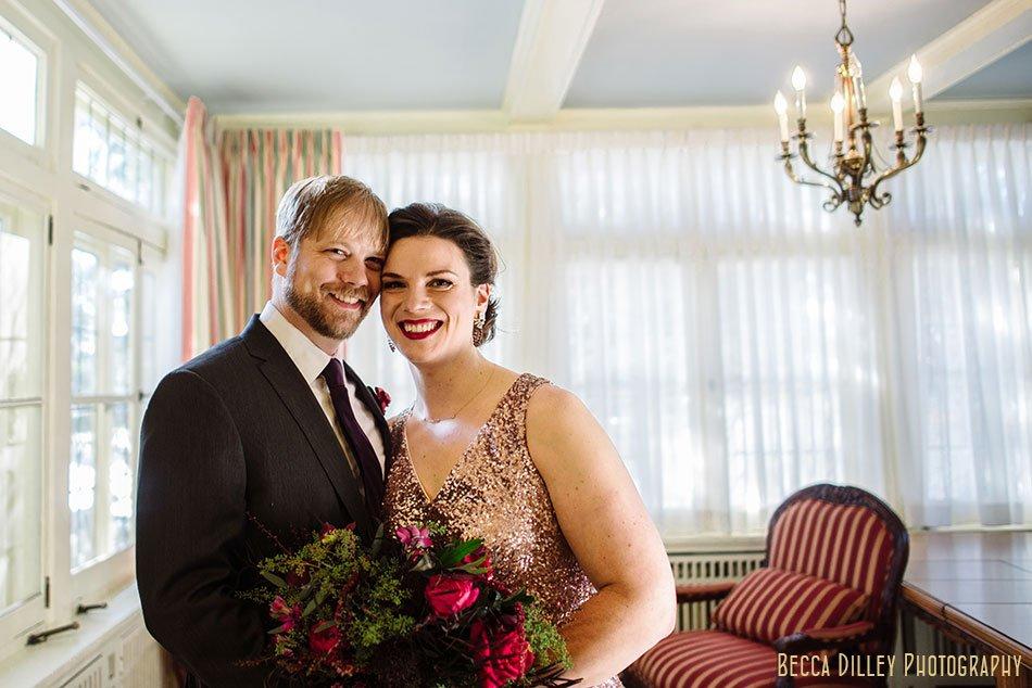 bride and groom in sunroom st paul college club winter wedding mn