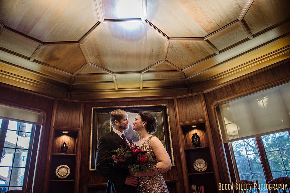 bride and groom in library st paul college club winter wedding mn
