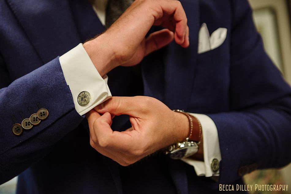 groom with cuff links