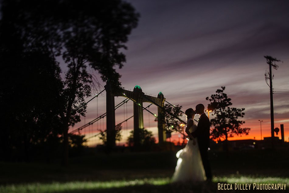 Bride and groom at night Nicollet Island Pavilion Wedding Minneapolis