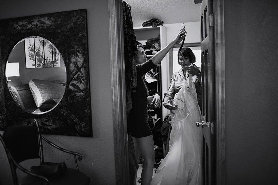 bride and mom get dress