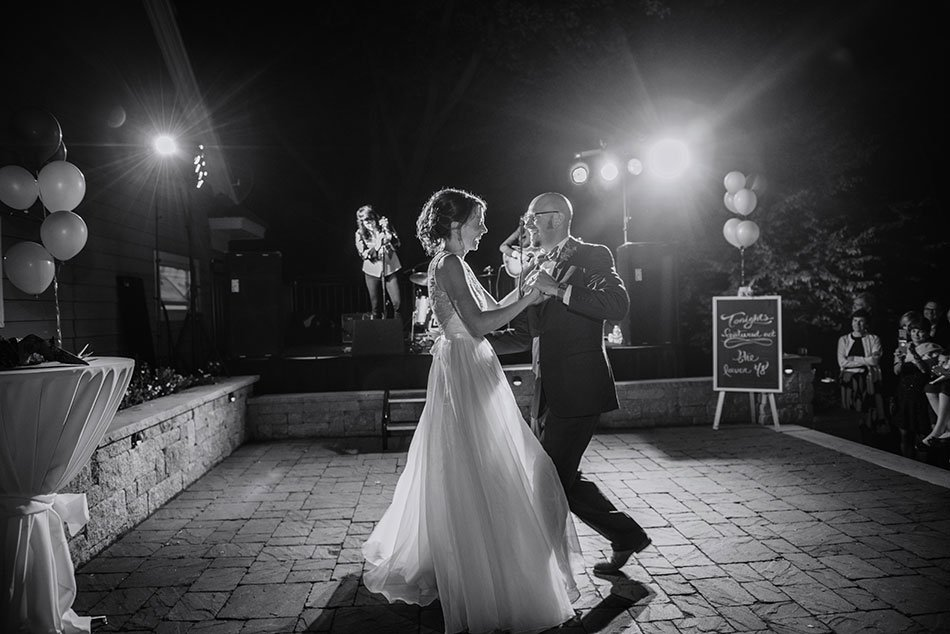 bride and groom first dance to lower 48 White Bear Lake Backyard Wedding