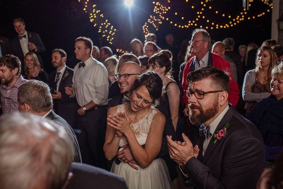 bride and groom with live band White Bear Lake Backyard Wedding