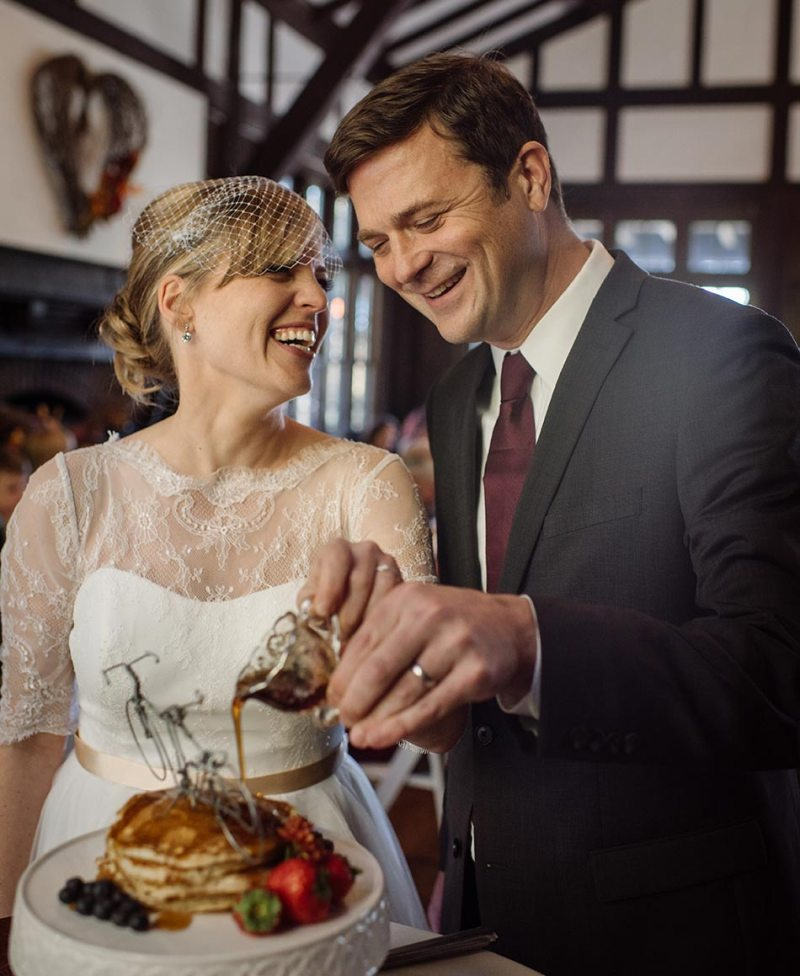bride and groom pour syrup on their wedding pancakes Theodore Wirth Wedding Minneapolis