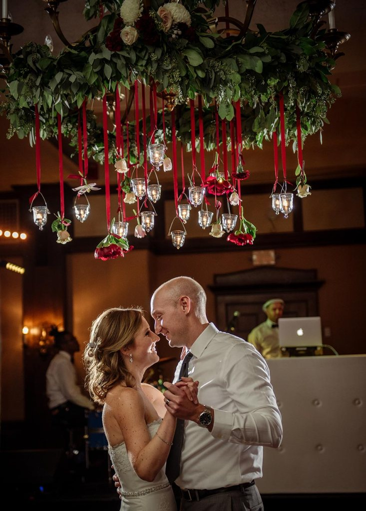 dancing under floral chandelier Wedding at Minneapolis Club