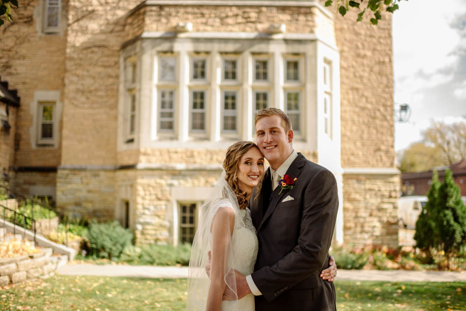 bride and groom in front of St Lukes Episcopal church wedding minneapolis
