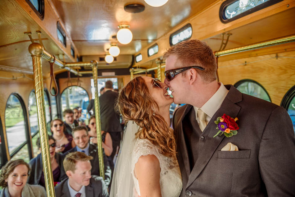 bride and groom in trolly renees royal valet St Lukes Episcopal church wedding minneapolis