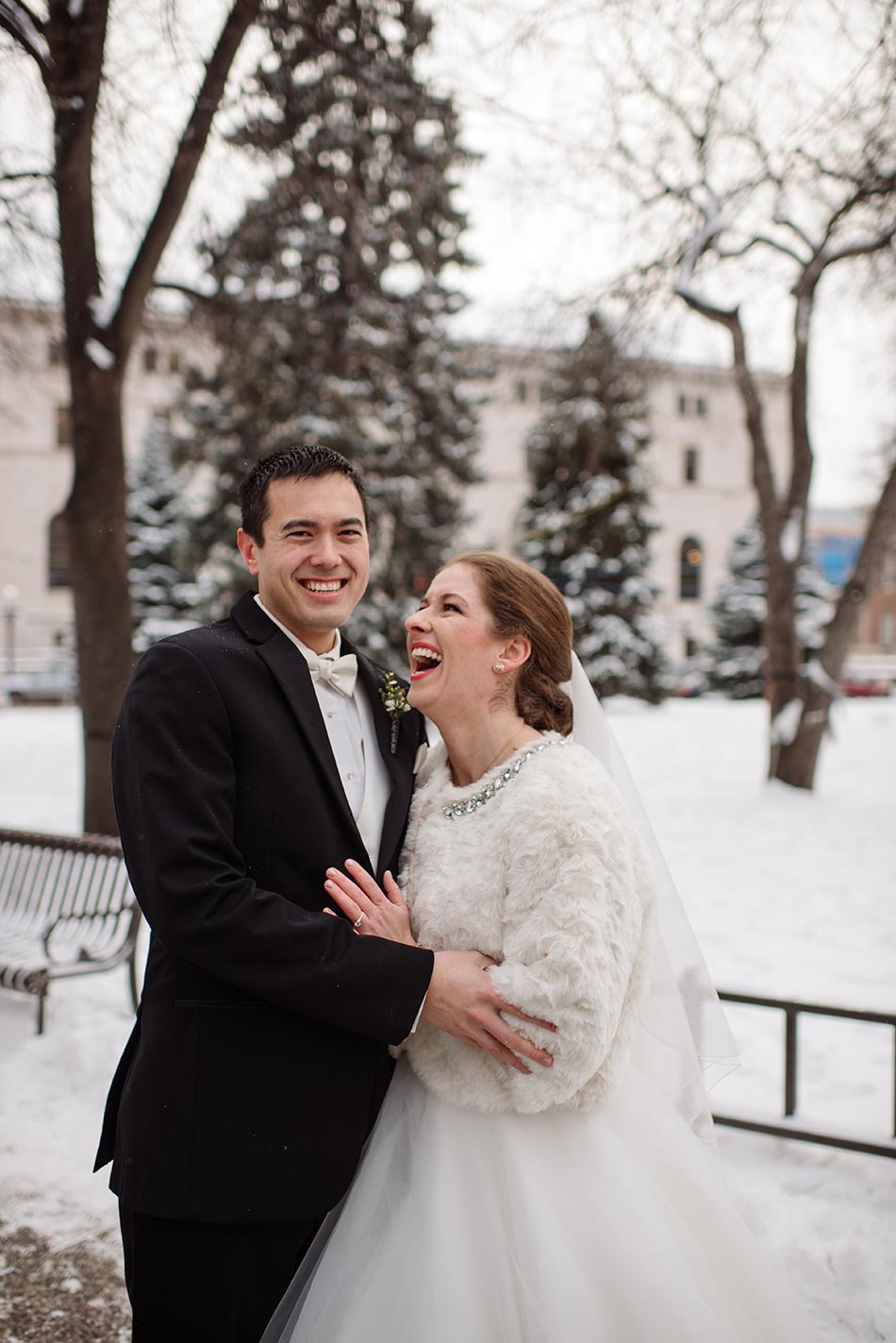 laughing couple St Paul Hotel winter wedding mn