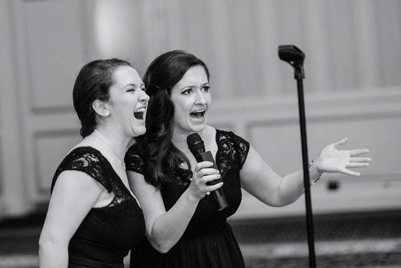 bridesmaids sing St Paul Hotel winter wedding mn
