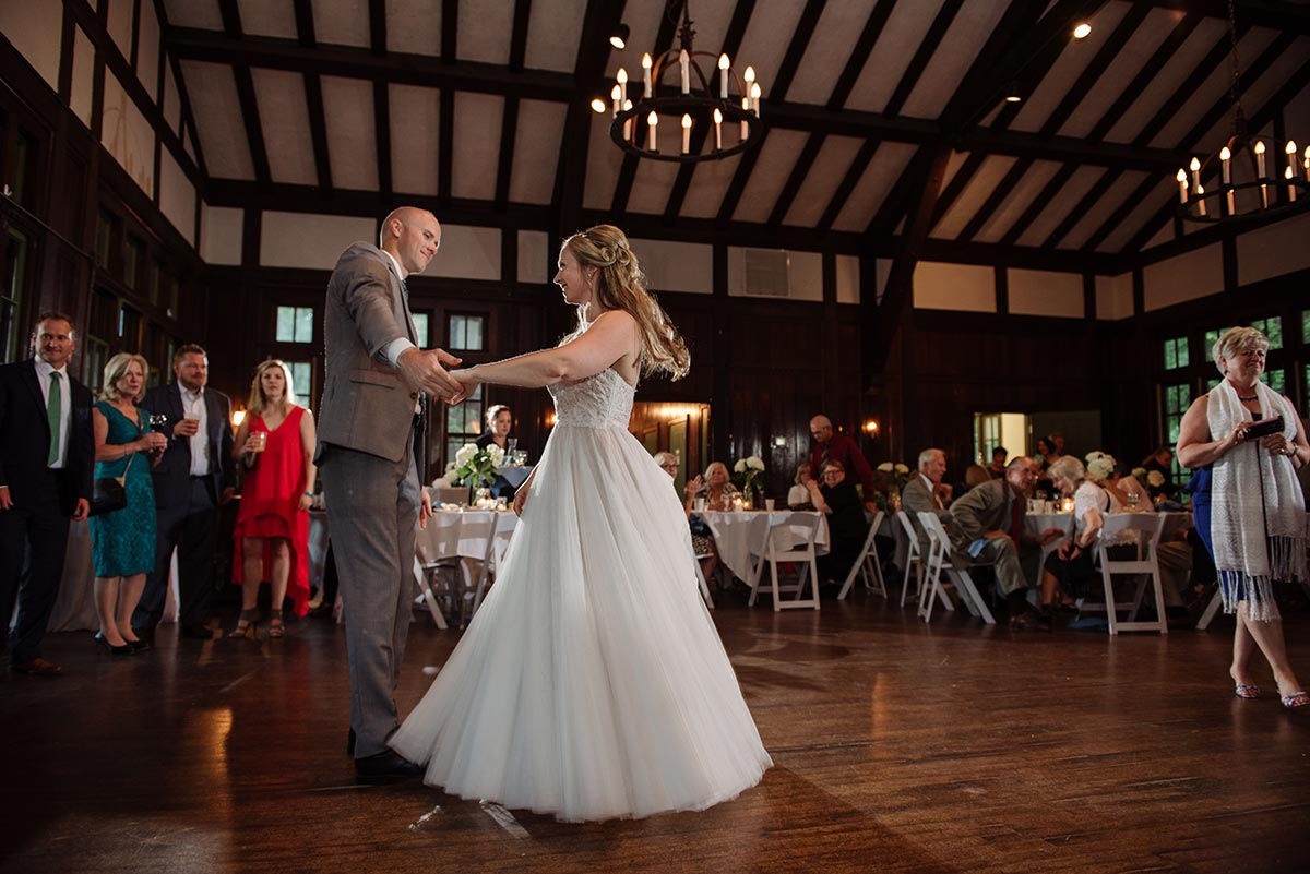 bride and groom have first dance inside Theodore Wirth Chalet Wedding