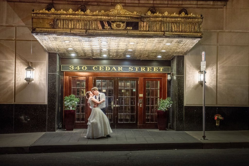bride and groom at night outisde st paul athletic club reception