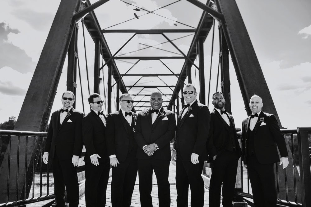 groomsmen on bridge eau claire wi wedding