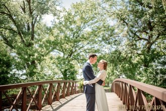 couple on bridge - If you are planning your MN elopement MInneapolis meets Finland wedding
