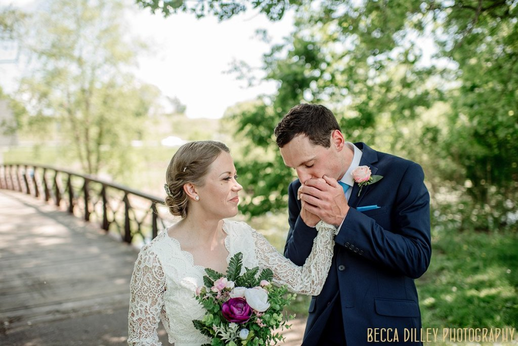 husband kisses wifes hand for If you are planning your MN elopement