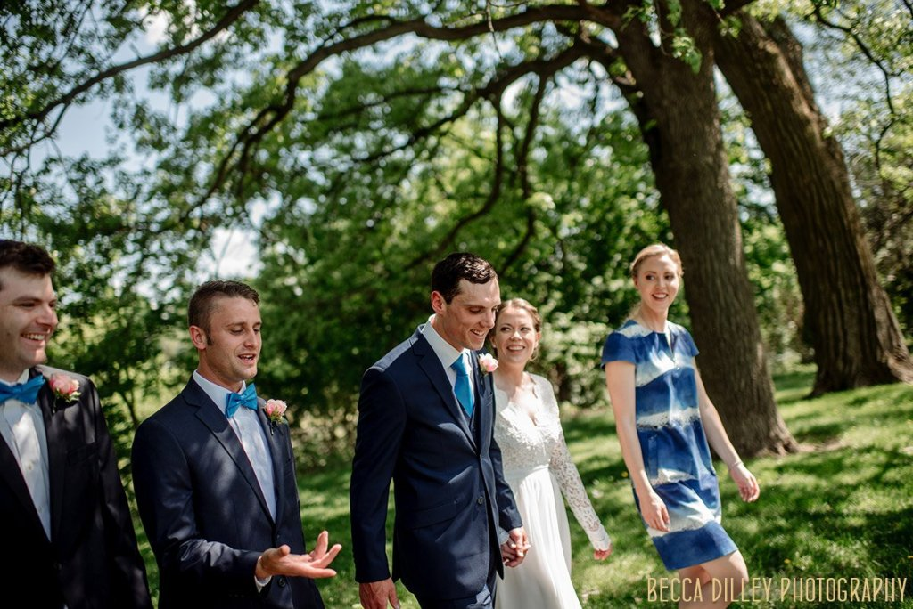 wedding party walking through summer park If you are planning your MN elopement