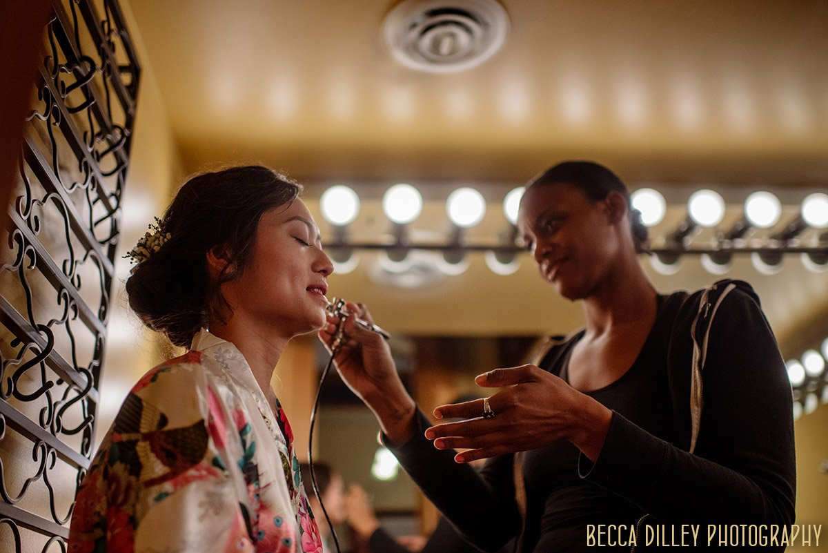 bride gets makeup put on Van Dusen Mansion Wedding Minneapolis