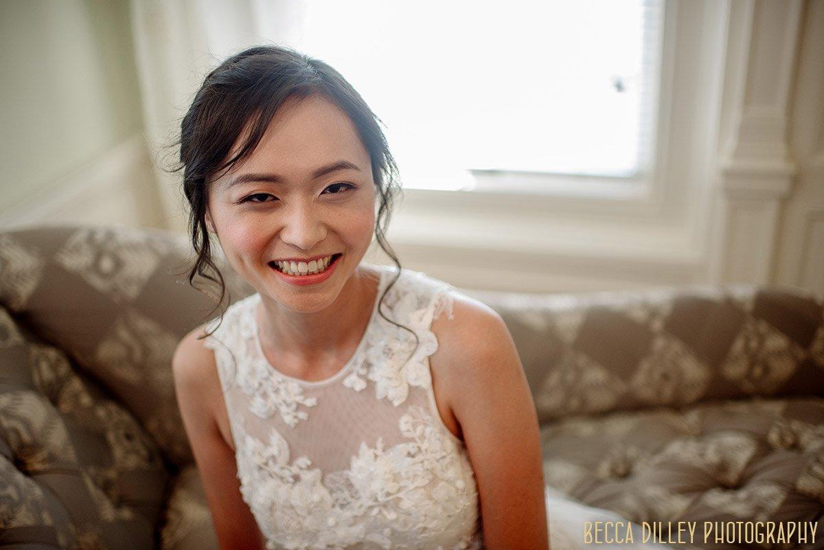 bride laughs inside bridal room at van dusen mansion