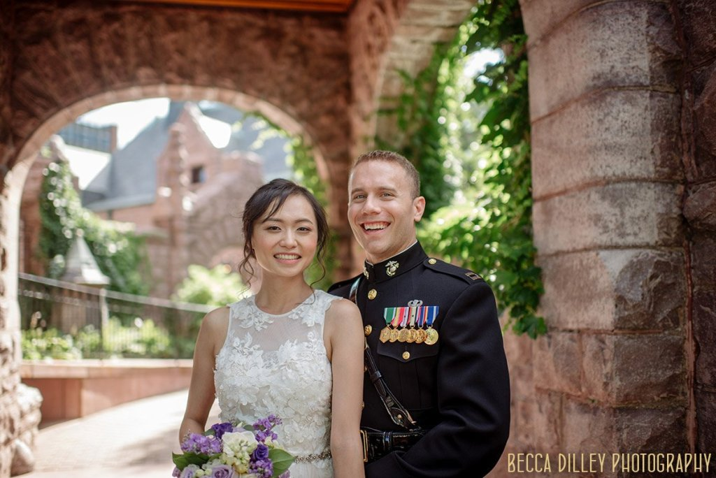 couple laugh outside in garden of Van Dusen Mansion Wedding Minneapolis