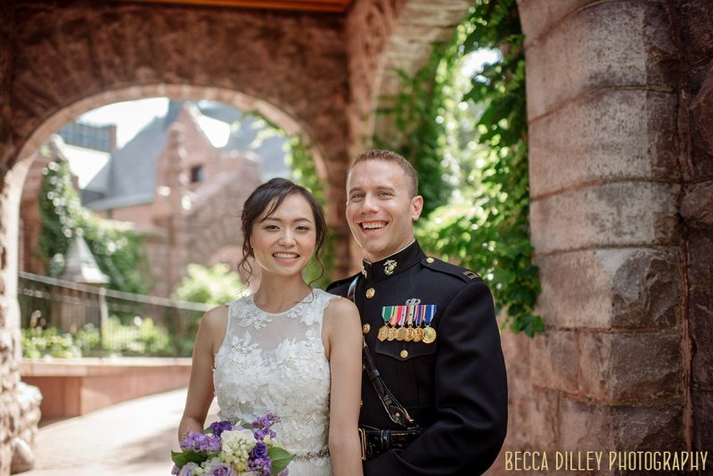 couple laugh outside in garden of Van Dusen Mansion Wedding Minneapolis
