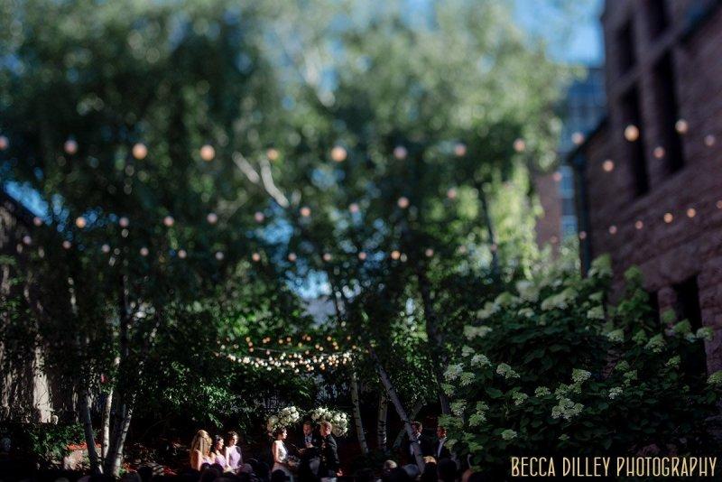 wedding ceremony in outside garden of Van Dusen
