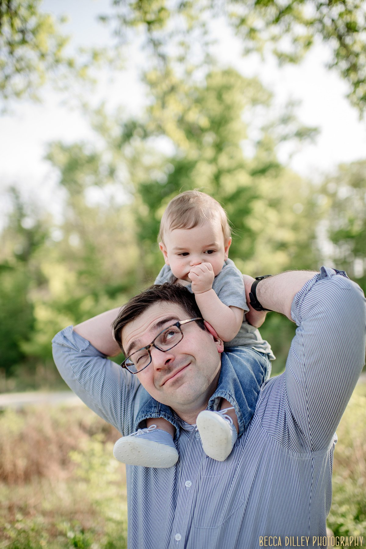 father with toddler son on shoulders