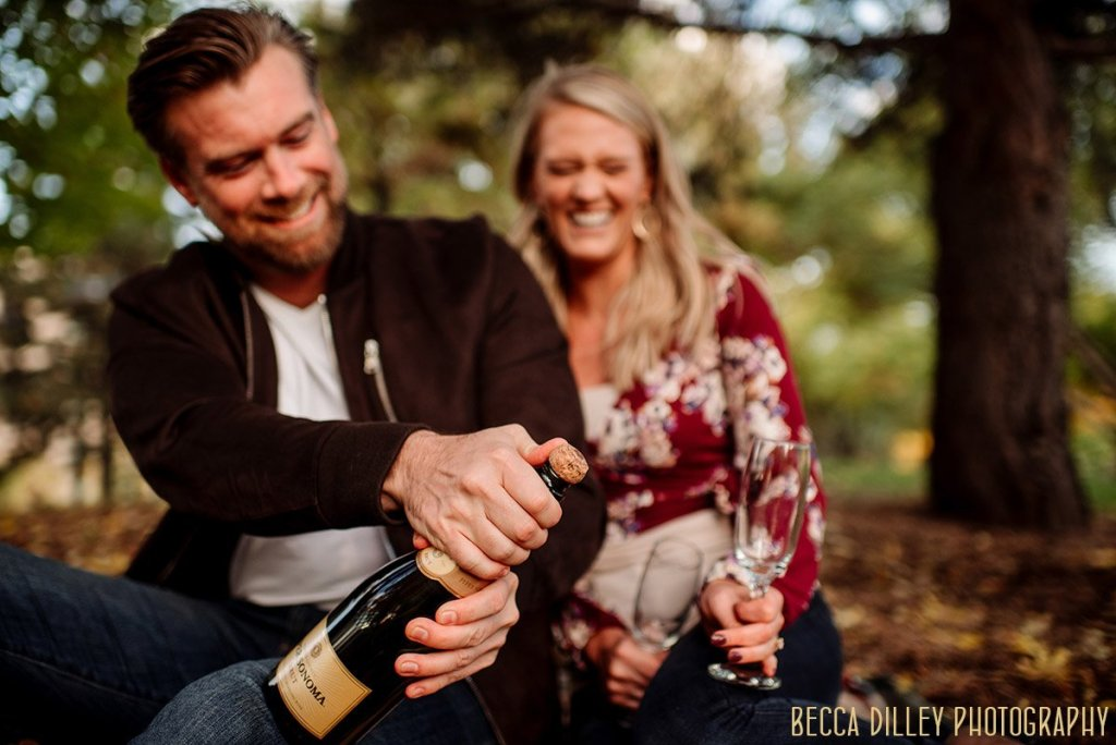 engagement photo with champagne