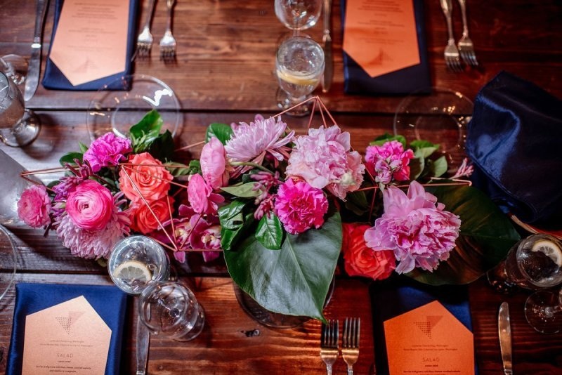 flowers on a table Machine shop wedding