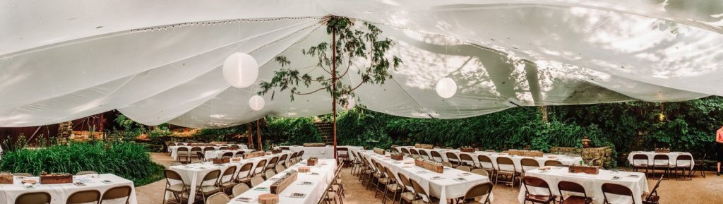 panorama of tent at hilltop wedding venue, spring green wi