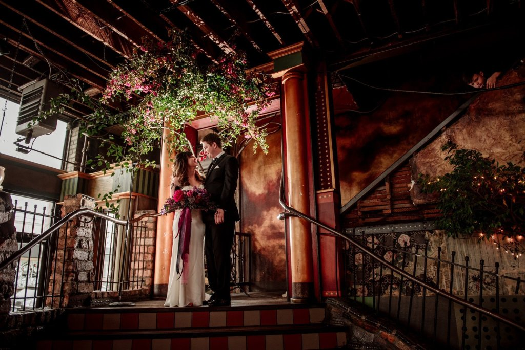 floral arch with couple loring restaurant wedding