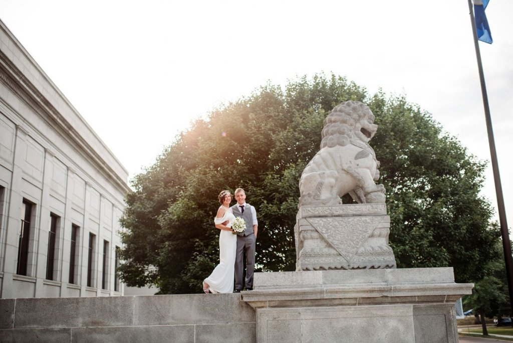 couple by stone lion statue outside Minneapolis Institute of Art