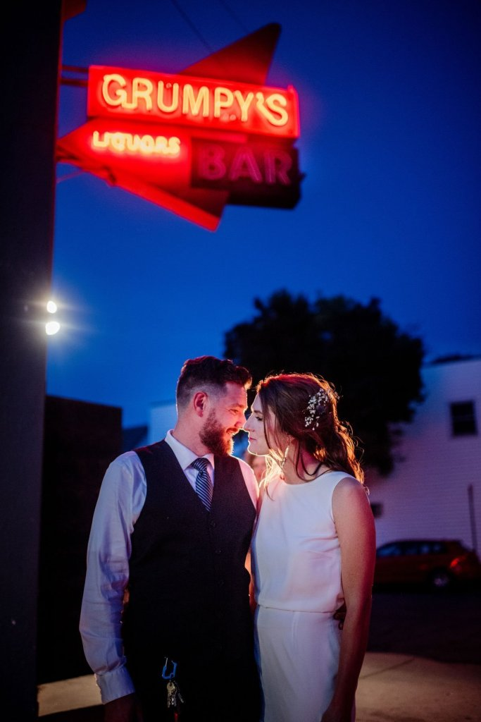 couple at night outside grumpys bar northeast minneapolis dive bar wedding