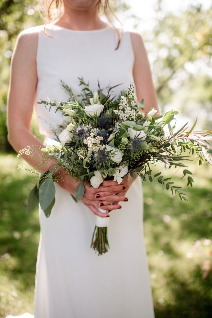 brides bouquet in minneapolis park before wedding sunny summer day