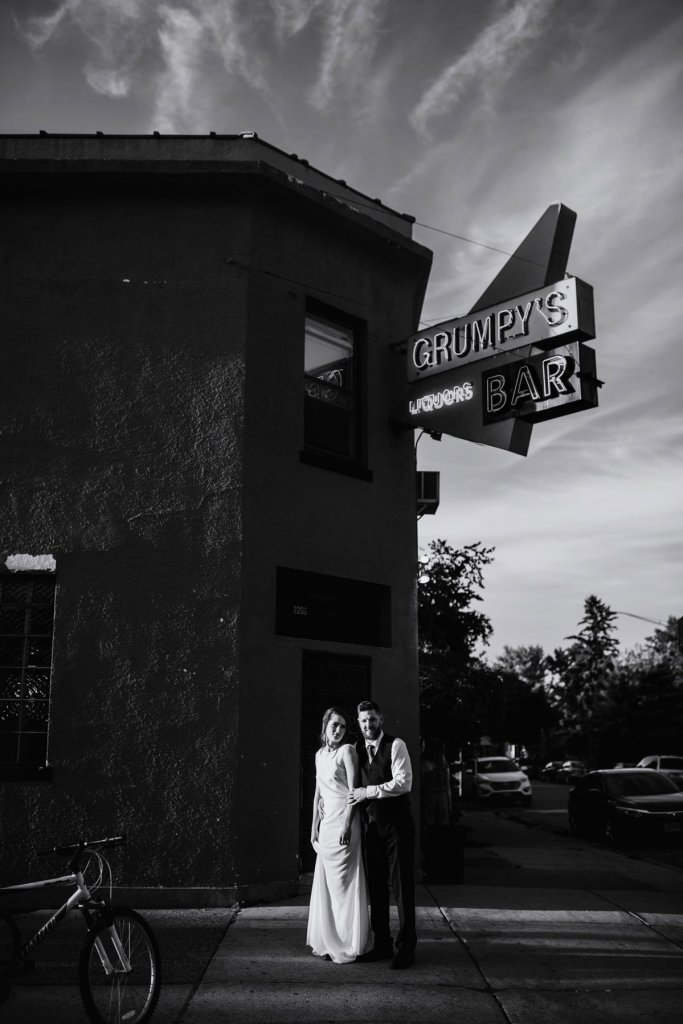 Black and white image couple at night outside grumpys bar northeast minneapolis dive bar wedding