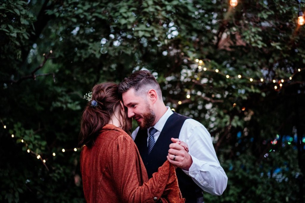 couple dance outside grumpys bar in northeast minneapolis for wedding