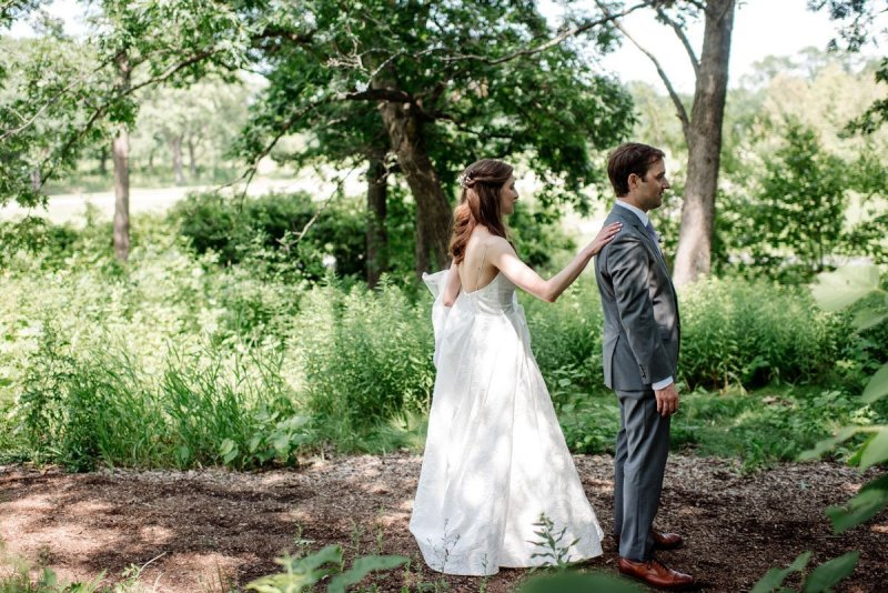 first look between bride and groom at silverwood park wedding mn