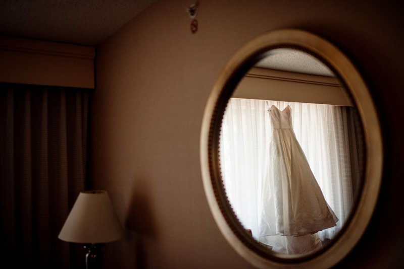 dress hanging reflected in hotel mirror