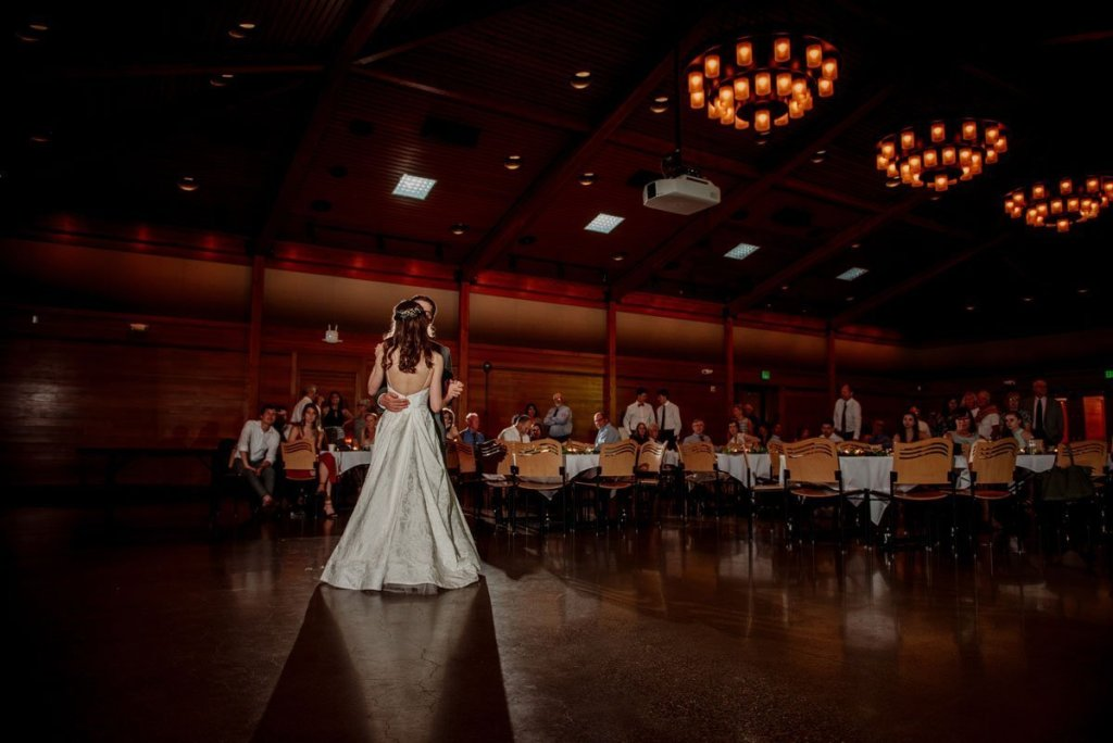 A first dance between bride and groom in reception space of silverwood park wedding mn