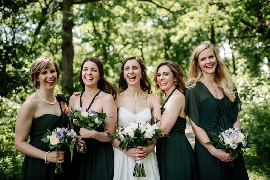 bridesmaids laughing under trees at silverwood park wedding mn