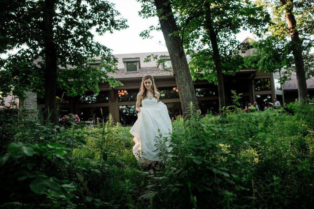 bride walking through grasses silverwood park wedding mn