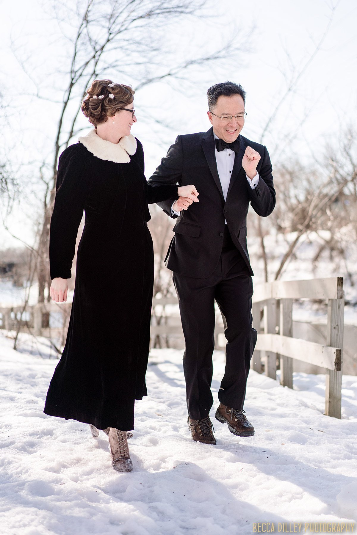 couple dance on snowy ice in minneapolis before winter elopement