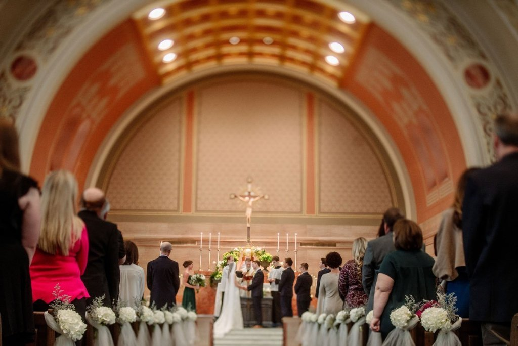 wedding ceremony under arched altar
