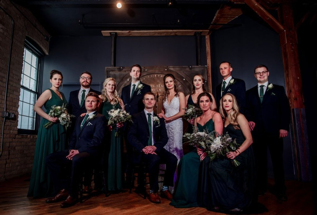flash composite of wedding party for dramatic dark lighting at solar arts building in minneapolis