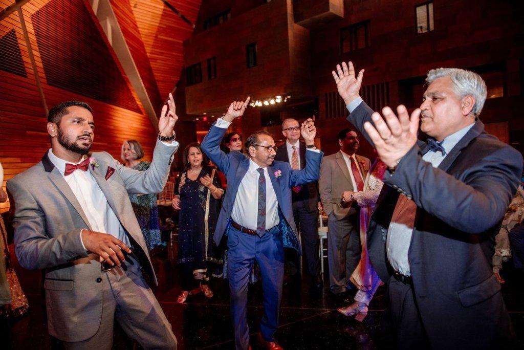 grooms father dances with abandon at McNamara wedding