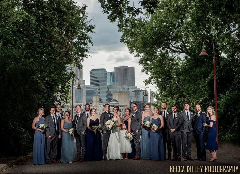 Dramatic portrait of a large wedding party at the stone arch bridge in Minneapolis - flash composite panorama of multiple images photoshopped together