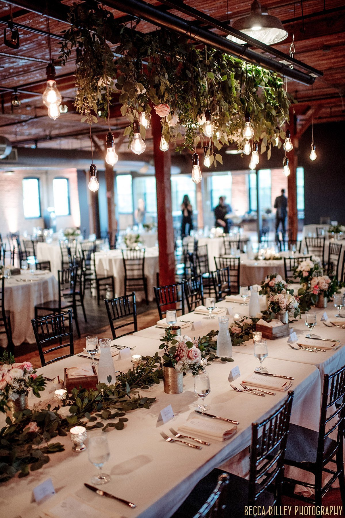 interior of solar arts wedding reception with tablesettings and flowers