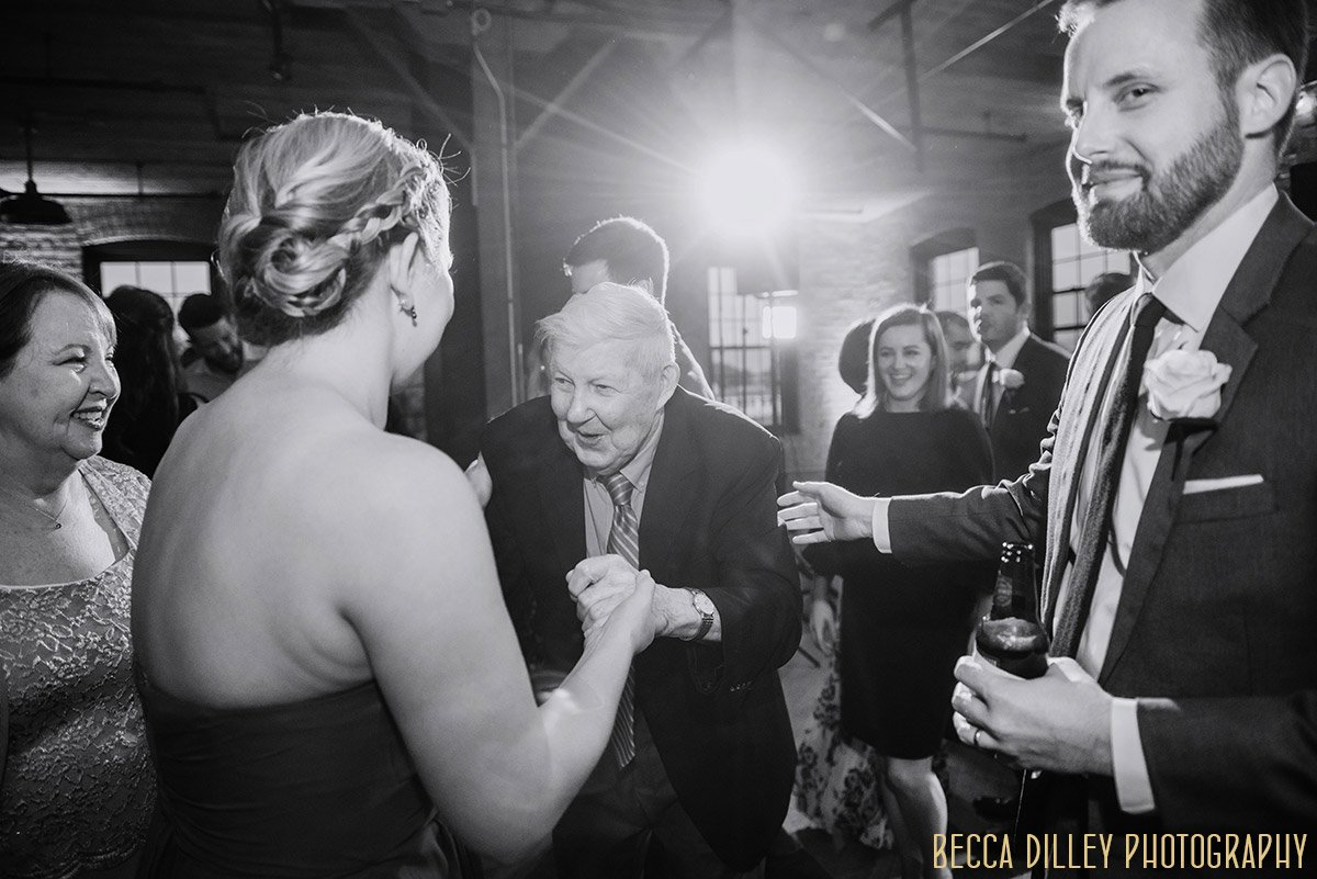 grandpa dances with bridesmaid solar arts wedding