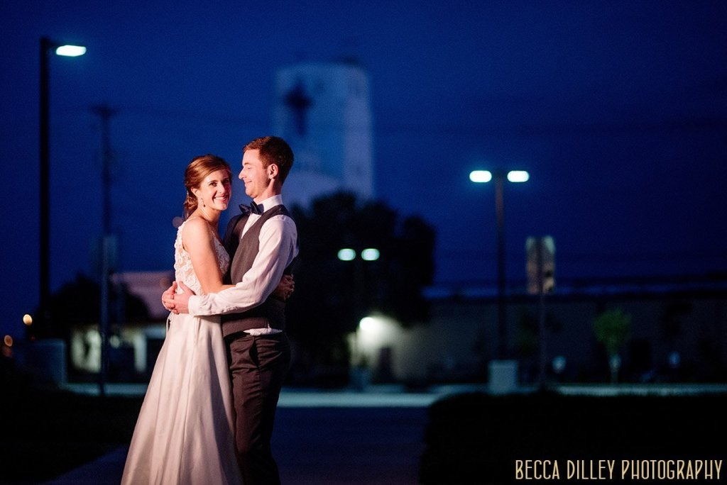 bride and groom with blue night sky behind them for final portrait at solar arts wedding