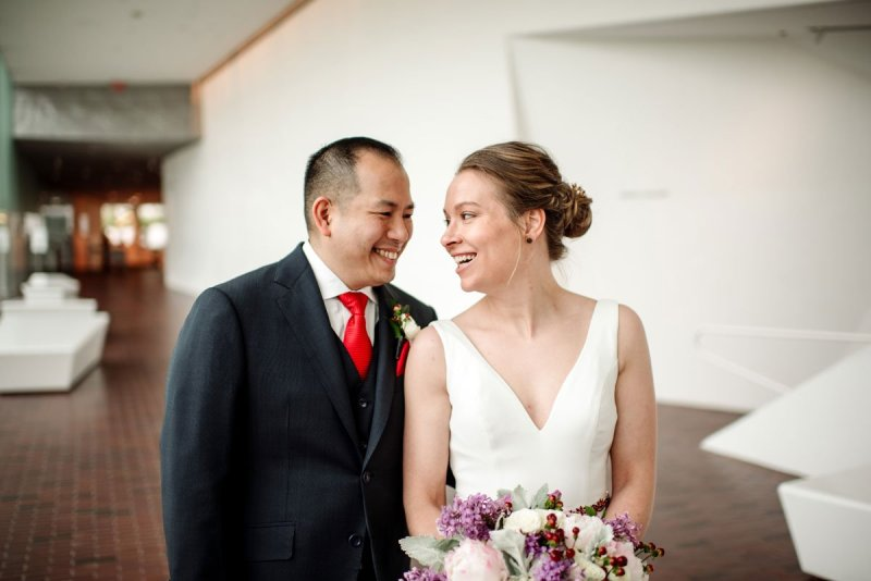 couple smiles at each other in modern space of walker art center
