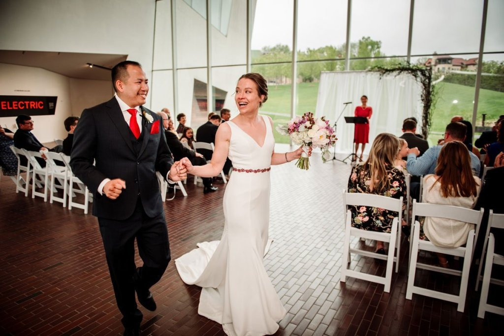 bride and groom dance down aisle after walker art center wedding ceremony