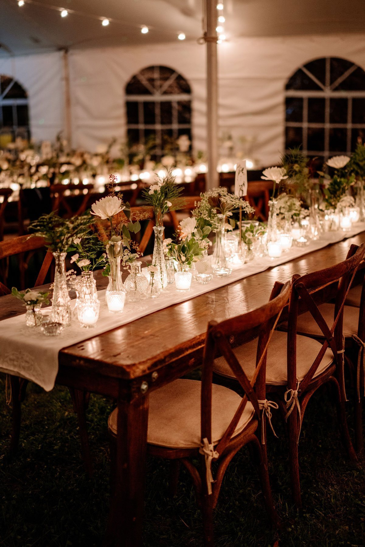 table in tent with candle light voyageur wedding environmental center mn